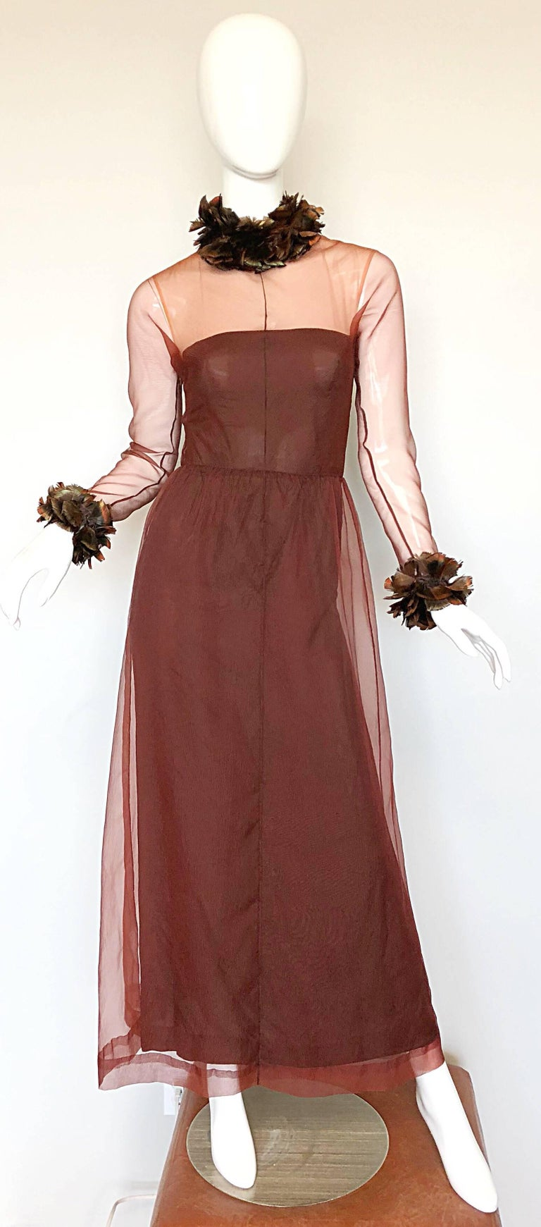 Amazing 60s GIVENCHY couture numbered chocolate brown silk chiffon evening dress! Features a nude illusion tailored bodice with semi sheer sleeves. Feathers around the full collar and sleeve cuffs. Full metal zipper up the back interior, and the