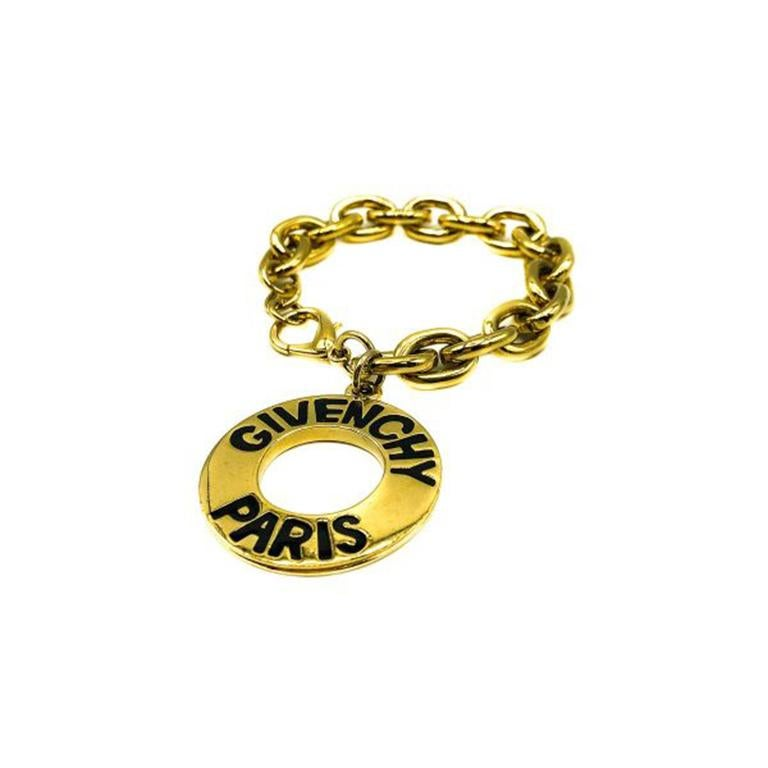 A super stylish Vintage Givenchy Logo Charm Bracelet. Crafted in gold plated metal with black enamelled lettering creating the logo look. The logo is repeated on both sides. In very good vintage condition, 22cm and can be fastened to suit. A truly