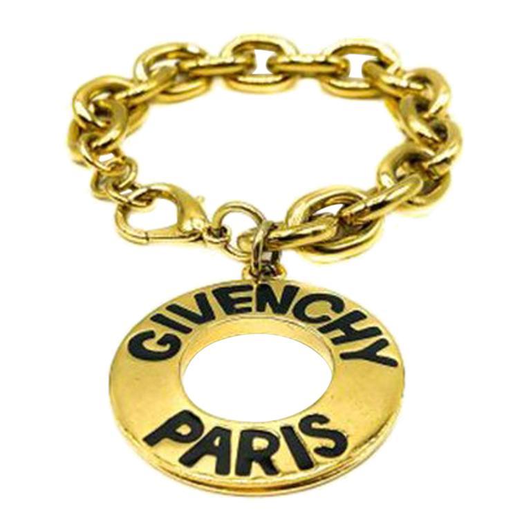 Vintage Givenchy Gold Logo Disc Charm Bracelet 1990S For Sale