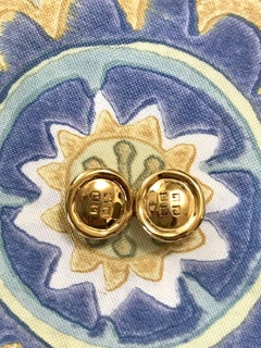 Givenchy Vintage golden round shape earrings with embossed logo mark