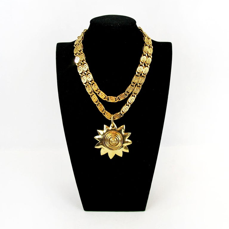 Vintage Givenchy necklace with sun motif pendant, France 1980s. Impressive Collier made of thick double chain with an amazing Sun motif pendant. In excellent preowned condition. Maker's marks, Givenchy Paris New York.  Measurements: Length 38 cm,