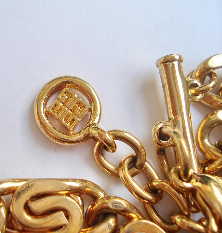 Metal Vintage Givenchy Necklace with Sun Motif Pendant, 1980s For Sale