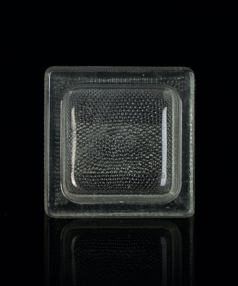 Glass ashtray from Saint Gobain is a wonderful glass decorative object, realized during the 1950s.   Very fashionable glass ashtray realized by Saint Gobain.   Laterally written in relief on the glass: SAINT GOBAIN PISA - NOVALUX Q 141.  Good