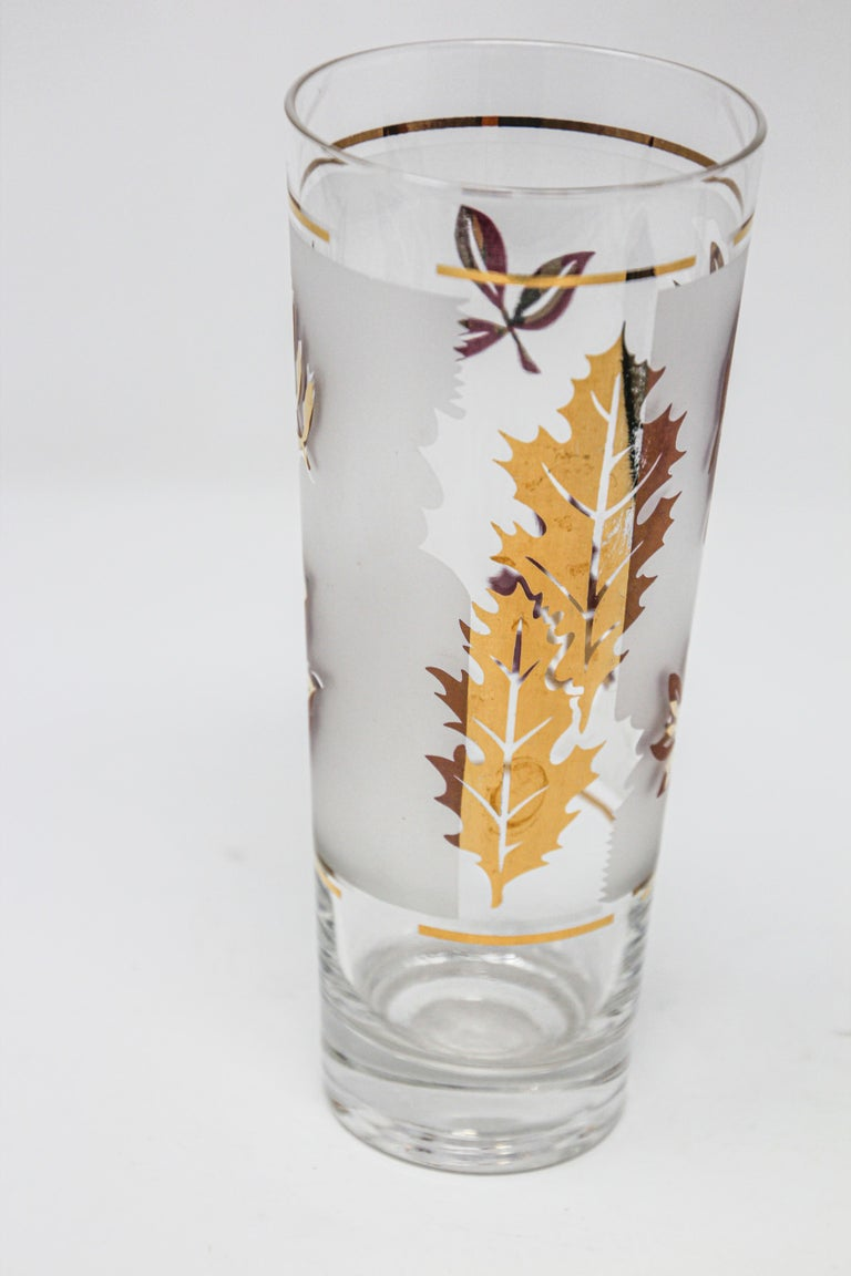 Vintage glass vase manufactured by Libbey. 1950s Hollywood Regency. Decorated with a classical gold lief pattern on frosted glass. In good condition, perfect for the holidays and gorgeous on display in a cabinet while not in use. Please see