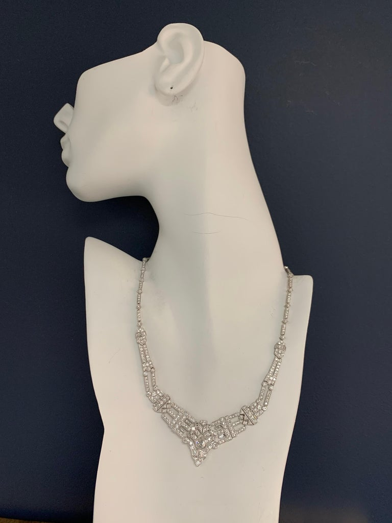 Approximately 8 Carat 18k White Gold vintage necklace set with 336 natural colorless diamonds.  The center Pear Shape is a natural  diamond approximate 1 carat, 8x5x3.8mm, H color and VS1 clarity.  The piece weighs 31.9 grams and is stamped