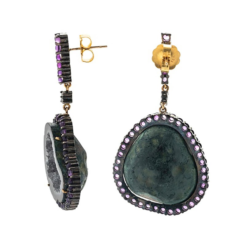 Pair of sparkling geode earrings with round cabochon amethysts measuring approximately 2.50-2.90 mm in diameter and four mixed cut diamonds. Earrings ore of the pierced variety and measure 2 1/8
