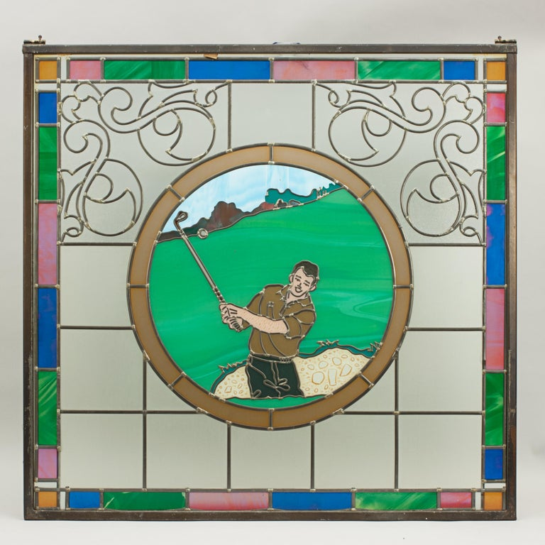A magnificent sporting stained glass window depicting a fishing scene. The window shows a male golfer hitting out of a bunker, the edging of the window made of coloured glass. The coloured leaded window was made for the centenary of the 'Mansfield
