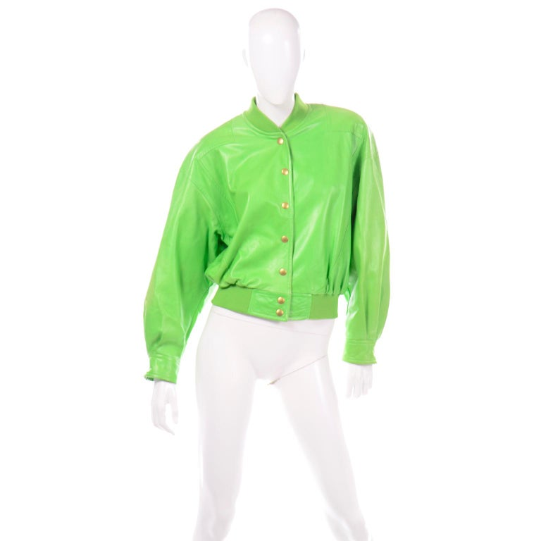 This fabulous vintage lime green leather bomber style jacket was designed by Margaretha Ley in the late 1980's. We especially love the green and blue leopard and tiger print silk lining.  This beautifully made jacket snaps up the front and has the