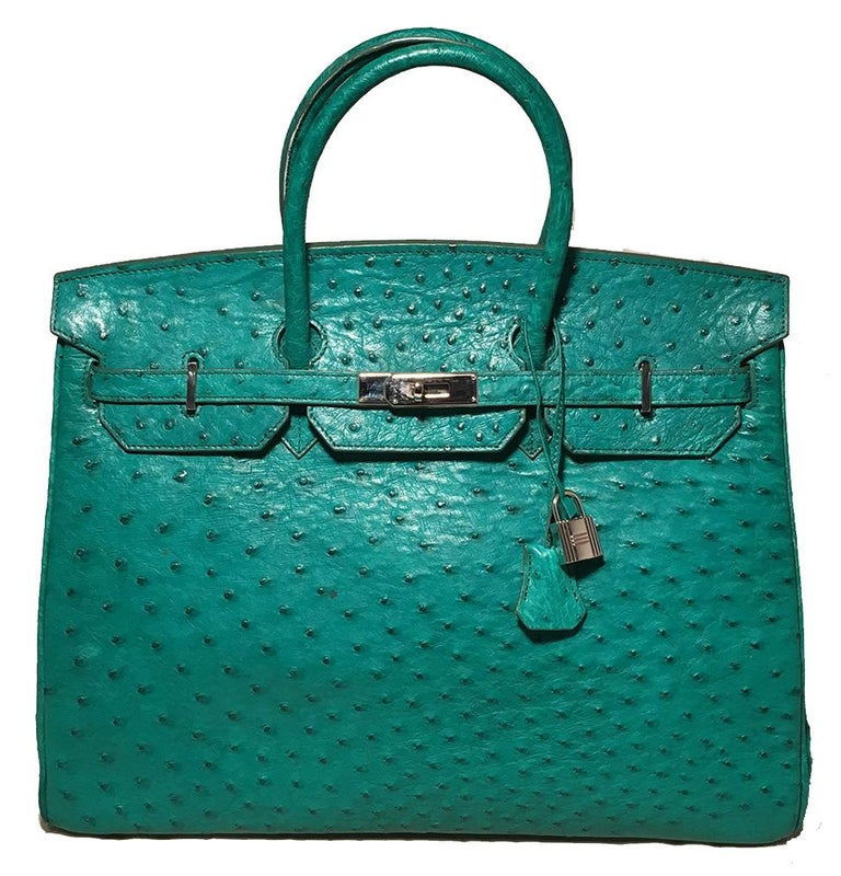 PLEASE READ FULL DESCRIPTION- this is a vintage designer piece made of genuine ostrich leather but is not Hermes.   Vintage Green Ostrich Birkin Bag in very good condition. Green ostrich leather exterior trimmed with silver hardware in classic