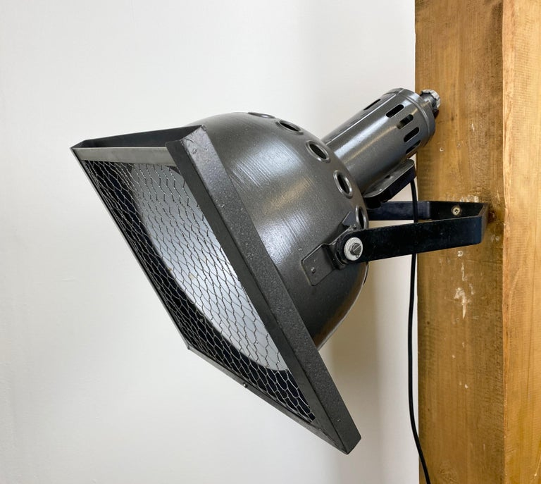 - Vintage theatre wall spotlight made in former Czechoslovakia during the 1960s  - It features metal grey hammerpaint body and iron grid - Socket for E27 lightbulbs and new wire  - The weight of the spotlight is 5 kg  - Fully functional, good