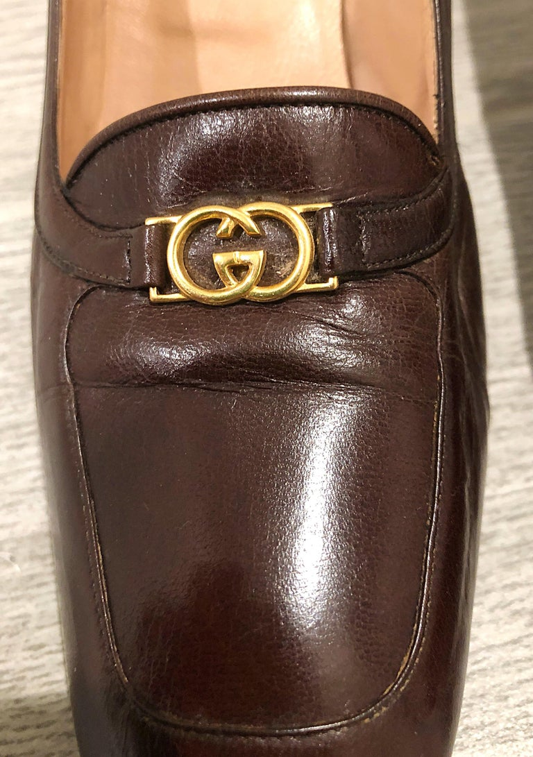 Rare 1970s Gucci Size 7.5 chocolate brown leather women's high heel loafers! The perfect brown color that goes with anything. Gold GG logo detail on each shoe. Can easily be dressed up or down. Great with jeans, a dress, a suit, or skirt. In good