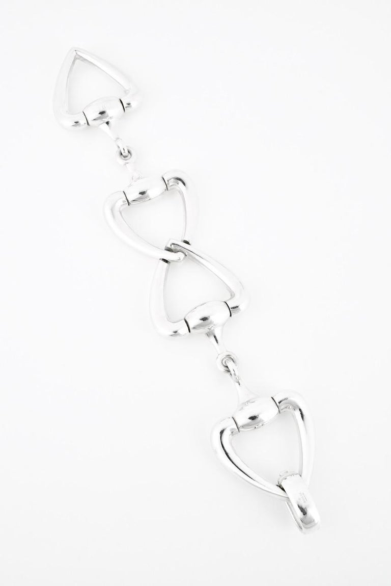 A vintage solid silver heart horse bit bracelet comprised of four heart shape motifs on either side of a horse bit link with a hinged closure - although a more recent piece, this heavy beautiful bracelet was produced in small numbers and so is a