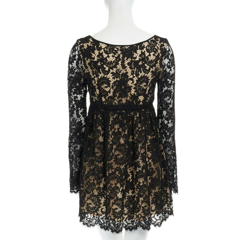 vintage GUCCI TOM FORD SS96 runway black lace scoop flare sleeve mini dress S  GUCCI BY TOM FORD FROM THE SPRING SUMMER 1996 RUNWAY ; CAMPAIGN Black floral lace dress. Angular scoop neck. Nude lining at bust. Drawstring detail at high waist. Long