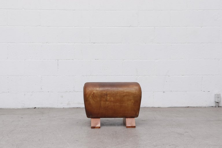 Original 1960s gym horse in natural leather with an amazing patina and custom feet. Others Available (LU922422301232, LU922422300852).