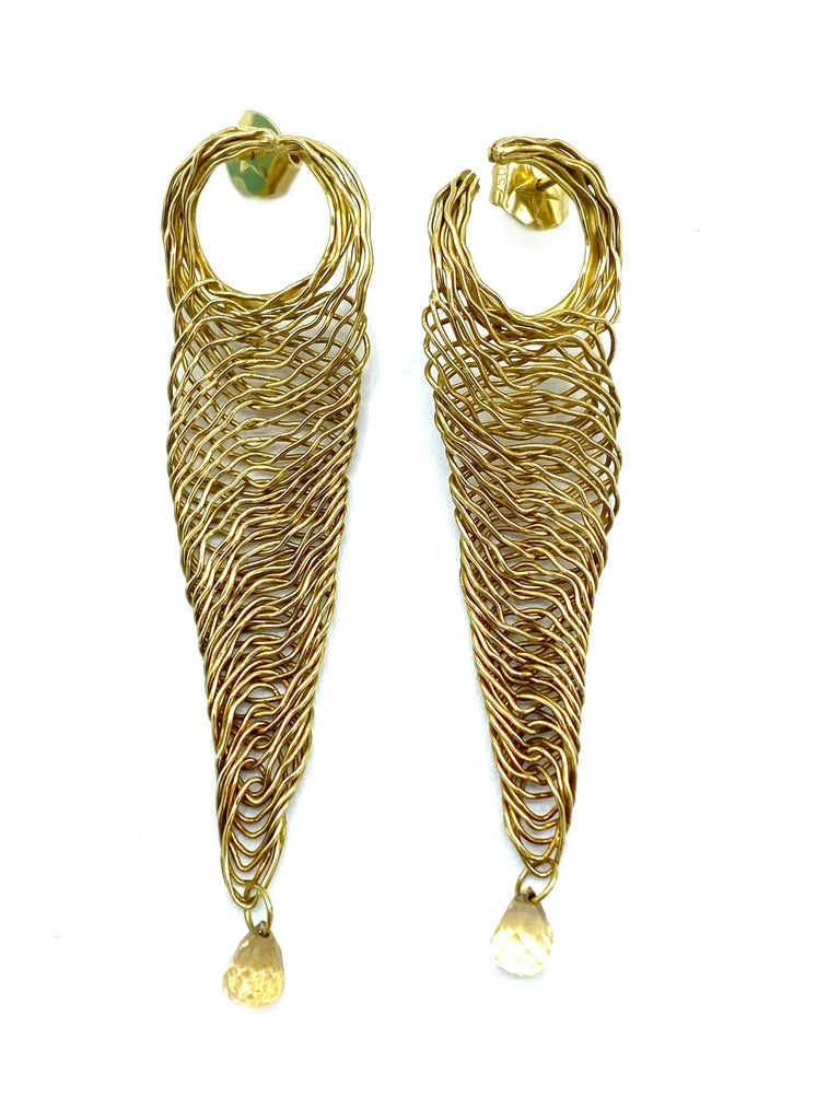 Product details:  The earrings are designed by H. Stern in 1990's, it is made out of 18 karat yellow gold and rutilated quartz. They feature wired finish and stud closure. Total weight is 13.4 grams. The measurements are 3 inches long and 0.75 inch