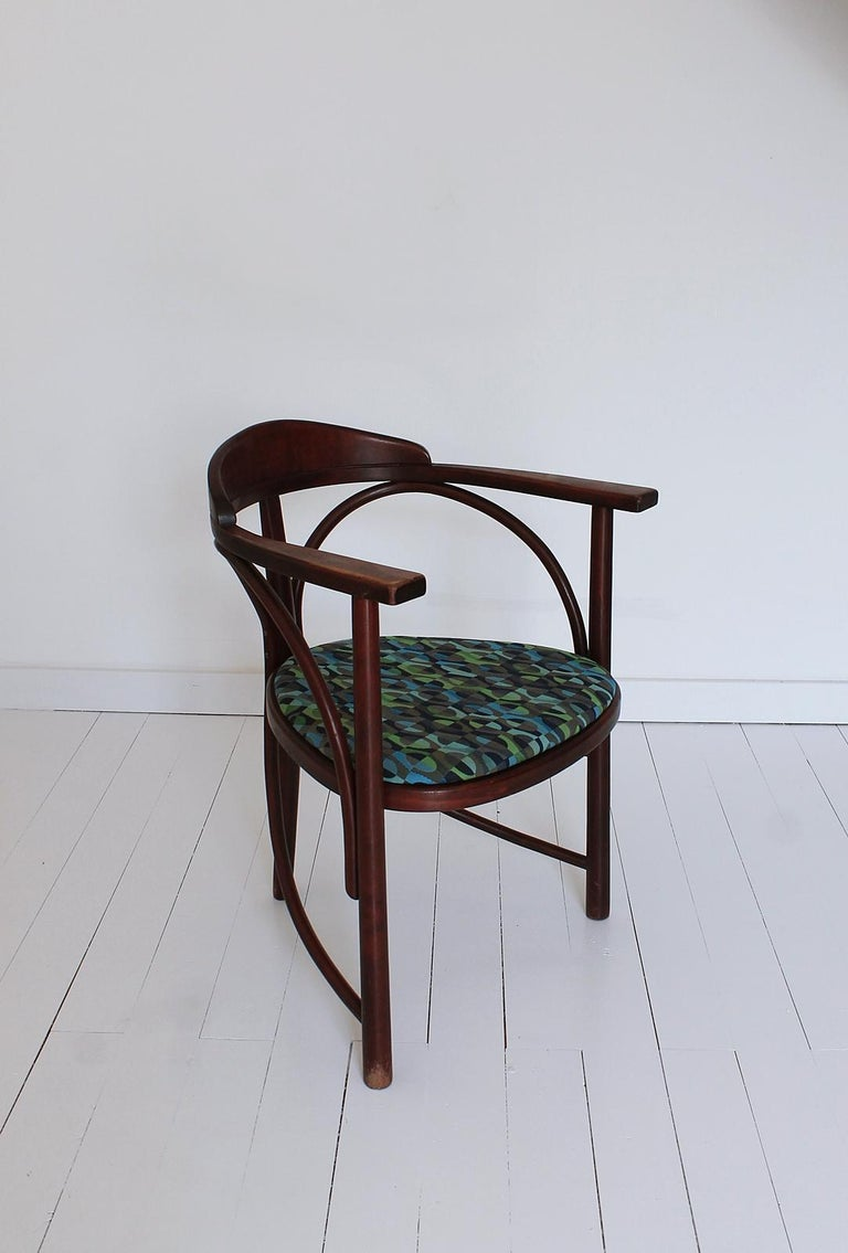 This stunning vintage Hajduthonet Rondo armchair was originally called the No 81 chair. It was designed between 1900 and 1904 by an unknown Austrian architect. For the time it was an avant garde design. The minimal frame is a perfect solution for