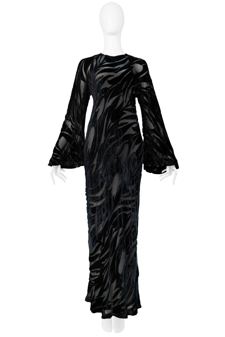 Vintage Halston bias cut black burnout velvet and chiffon evening gown featuring a tulip pattern, bell sleeves and keyhole back detail over a peach-tone slip dress.  Excellent Vintage Condition.  Size: Small  Measurements: Gown Bust 34