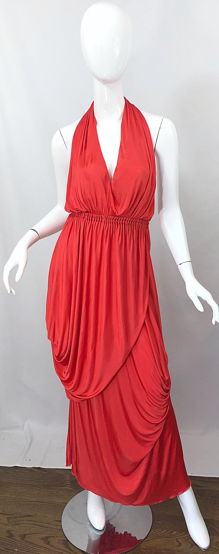 Sexy vintage HALSTON coral silk jersey plunging asymmetrical hem backless wrap gown! Features layers of silk jersey that effortlessly drape the body. There are no zips on this rare gem; the dress simply slips over the head, then you wrap one side to