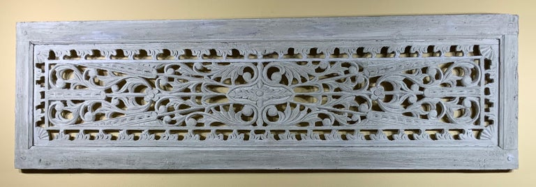 Beautiful wood hand carving wall hanging from solid wood, with vine, flowers and arrows motifs hand painted in gray color. Very impressive wall hanging.