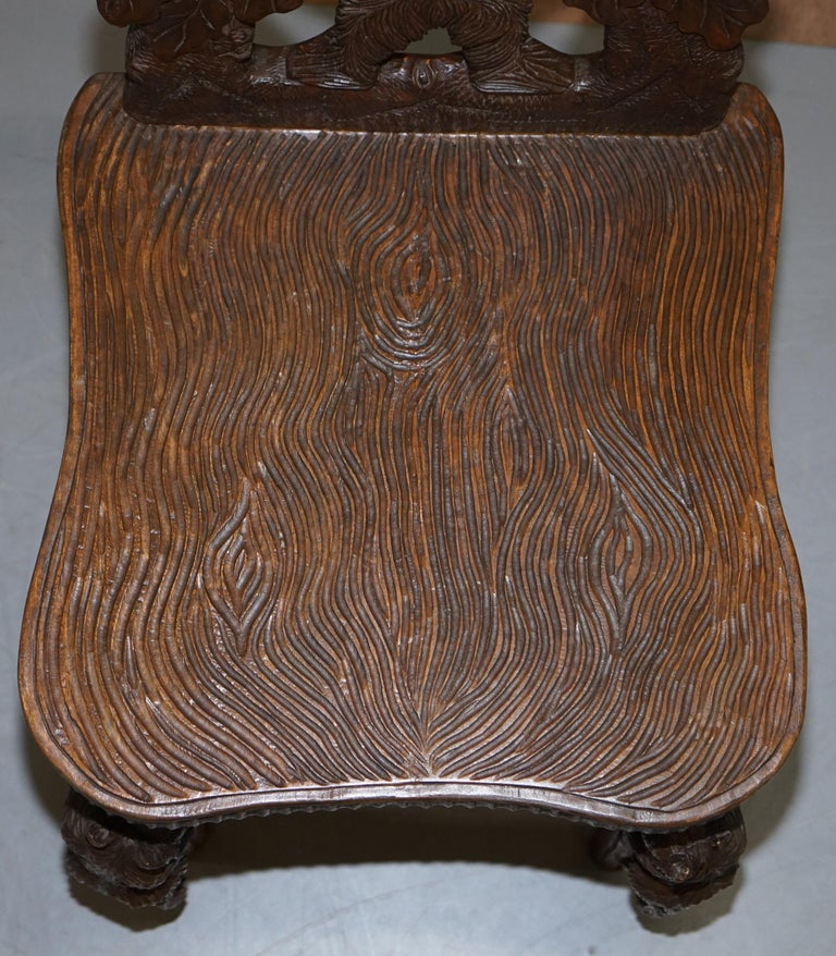 20th Century Vintage Hand Carved Black Forest Wood Bear Chair with Bears Climbing the Legs For Sale