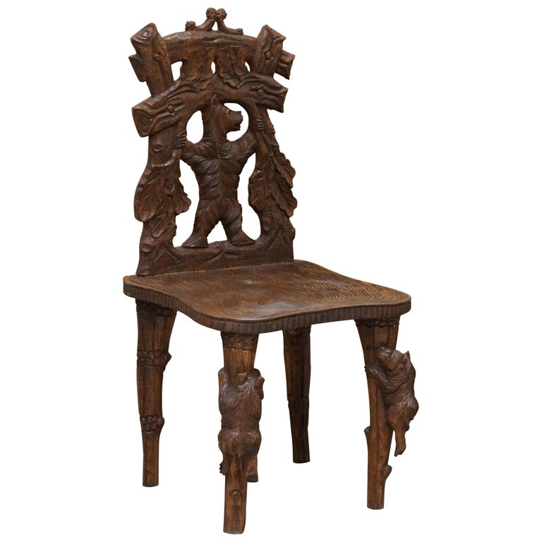 Vintage Hand Carved Black Forest Wood Bear Chair with Bears Climbing the Legs For Sale