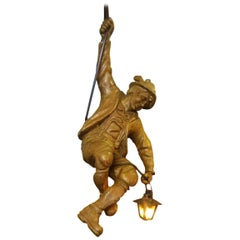 Vintage Hand Carved Mountaineer Sculpture Pendant Light with Glass Lantern