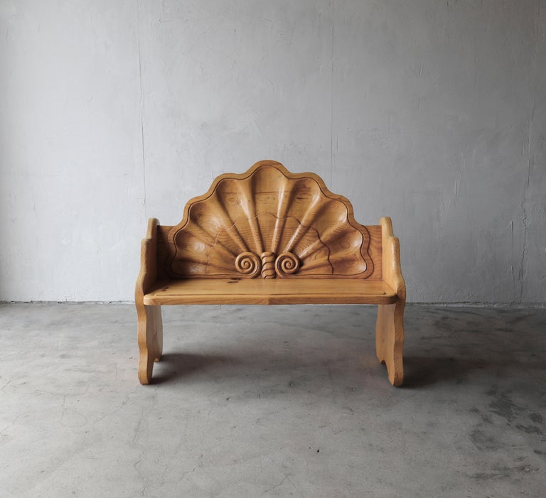 A true one of a kind piece, a conversation piece. Hand carved with no detail spared. If you're looking for a unique piece, something different, to put in a space that adds interest and function, look know further. This gorgeous bench is true art but