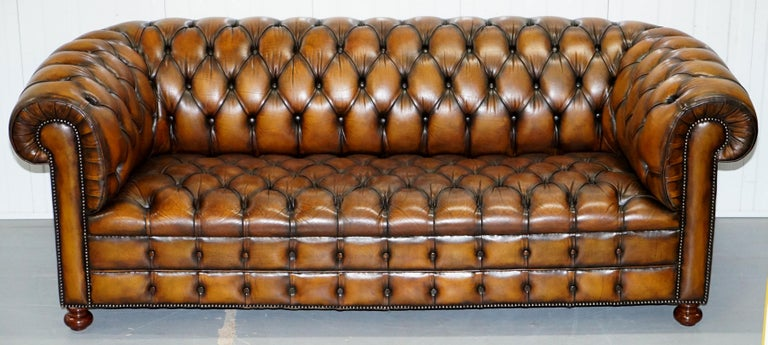 We are delighted to offer for sale this rare original vintage Whisky brown leather Chesterfield club sofa in newly restored condition with fully buttoned base   This sofa is one of a pair, I have another which is exactly the same model going