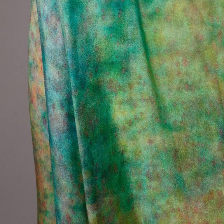 Gorgeous vintage hand painted silk maxi skirt in shimmering pastels. Unlined with hook and snap closure. There is no marked size but the skirt fits like a modern size medium. The waist measures 28-32