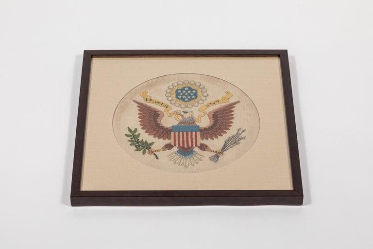 Vintage handstitched wool and linen crewel panel / US National Emblem, newly framed.