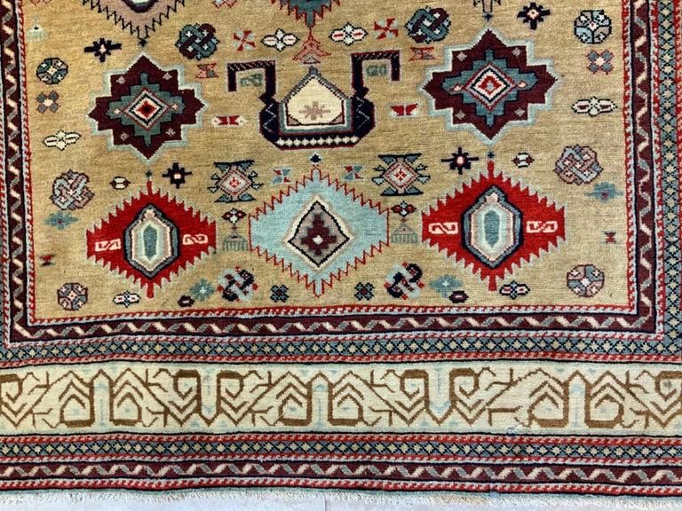 Wool Vintage Handwoven Kazak Motifs Rug For Sale