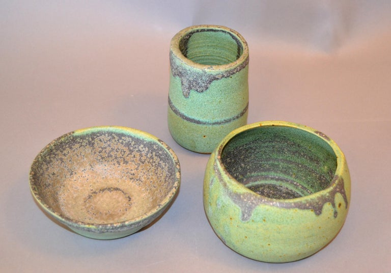 Set of 3 vintage handcrafted Aztec green, gray and brown group of pottery bowls, vessel. Makers mark underneath, NG. Dimensions: Flat bowl diameter 6 inches, height 2.25 inches; Tall small bowl diameter 3.75 inches, height 5 inches; Bowl