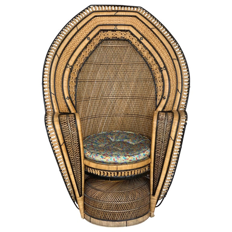 Stunning handwoven vintage peacock chair from the 1970s. Please note the details and different techniques in this chair.  Made out of wicker, rattan and reed. Great for indoor and outdoor use.  Measures: Seat and cushion diameter 21in.