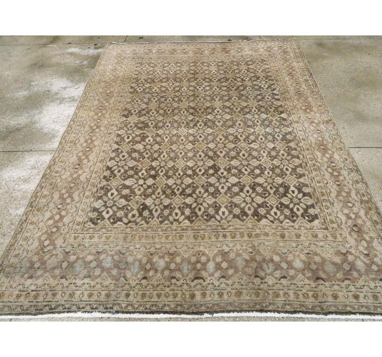 A vintage Persian Mahal accent rug handmade during the mid-20th century.