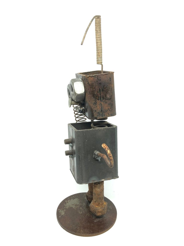 A handmade scrap metal robot statue. Some parts are rusty some with patina. A nice architectural sculpture for every living room or men's cave. Some scratches and a nice patina due to the age.