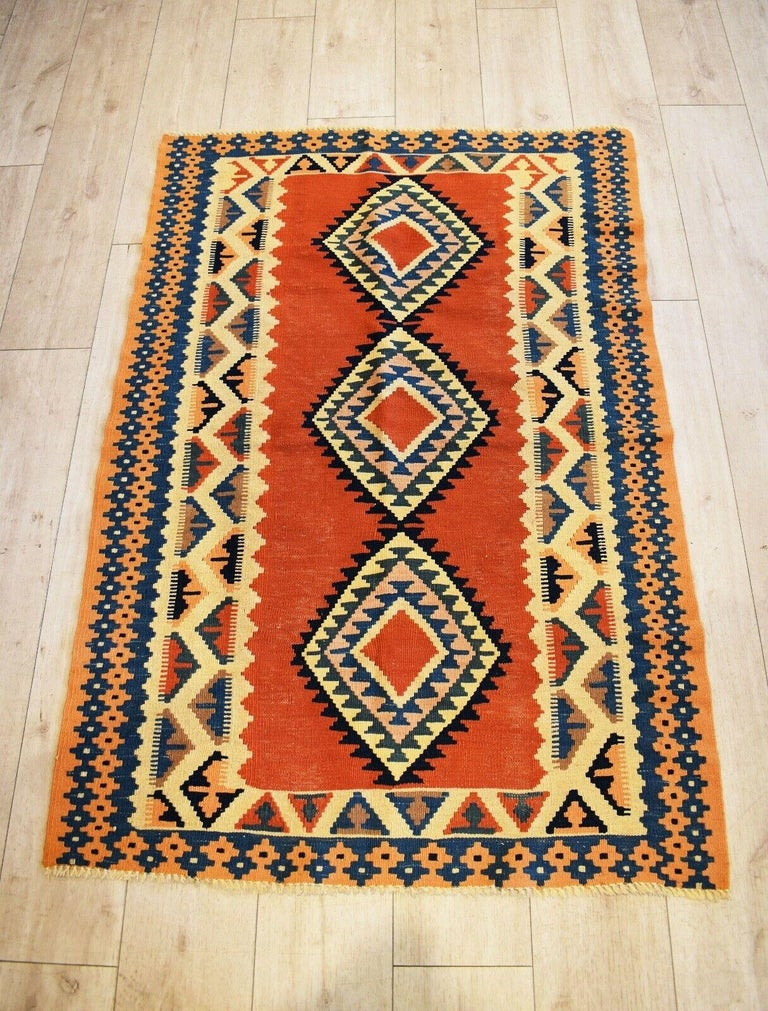Very rare and unusual beautiful handwoven vintage Kilim runner with patterns in shades of natural dyed orange, blues, black, and yellow colours Handwoven with natural dyes. Has a lovely aged patina & nice quality.