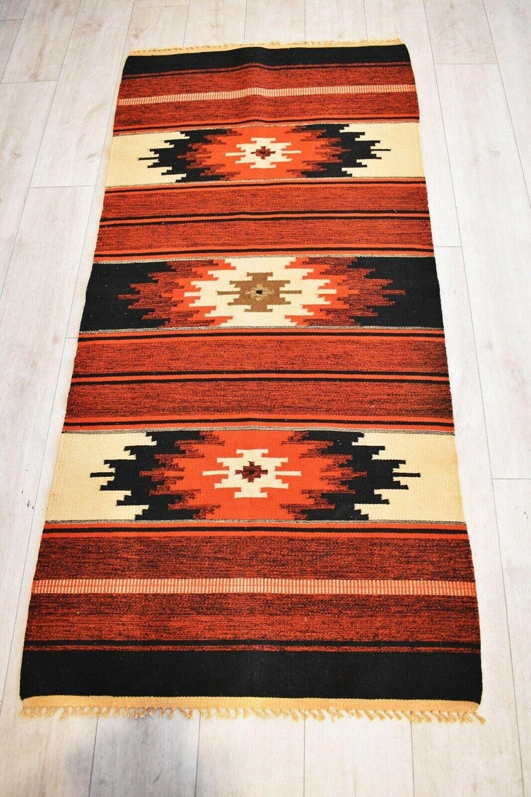 Very rare and unusual beautiful handwoven vintage Kilim runner with Classic Indian Tribal patterns in shades of Earthy red, orange & black on a straw coloured background with a beautiful tasseled edges. Handwoven with natural dyes.