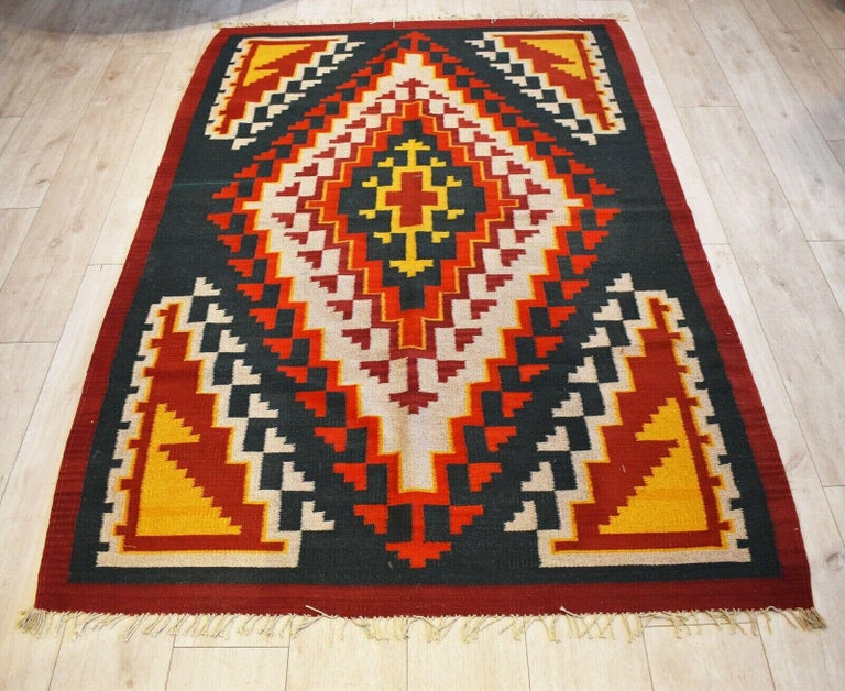 Very rare and unusual beautiful handwoven vintage Kilim runner with patterns in shades of natural dyed red, orange, charcoal black, and yellow colors Handwoven with natural dyes. Has a lovely aged patina & nice quality.