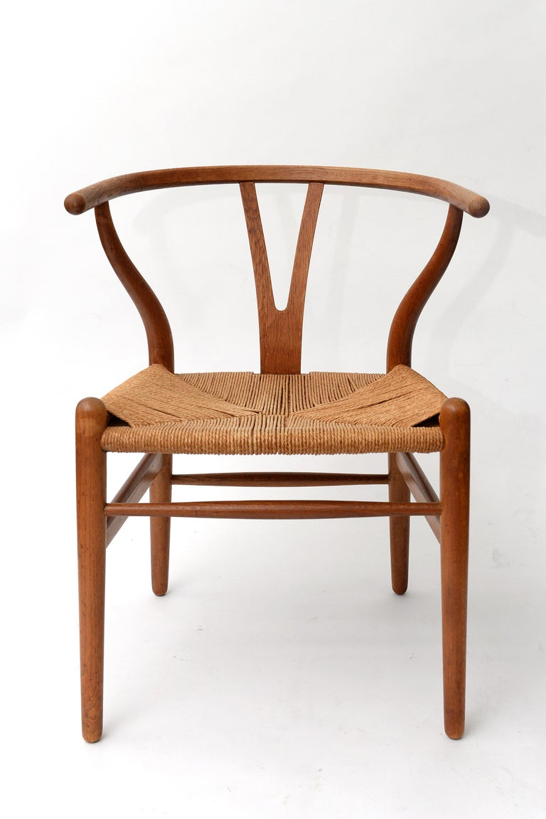 Beautiful set containing a Mid-Century Modern wishbone chair by Hans Wegner for Carl Hansen & Søn and a Jorgen Baekmark stool.  The two pieces have a similar design and are made of the same materials. They maych perfectly and create a fine looking