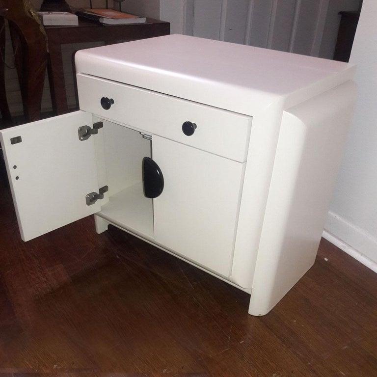 Vintage Harold Schwartz Romweber Art Deco white lacquered nightstand  White lacquered nightstand. One-drawer with shelving below.  Black circular pulls.