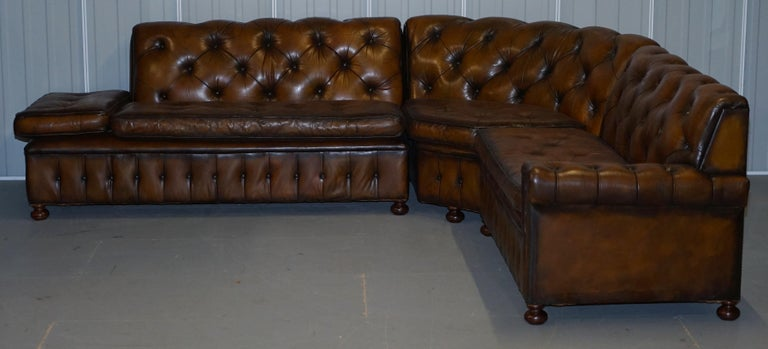 We are delighted to offer for sale this stunning custom made to order vintage fully restored hand dyed cigar brown leather Chesterfield corner sofa with solid hand turned walnut bun feet