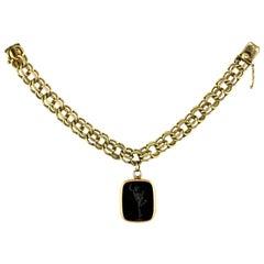 Vintage Heavy 14 Karat Flexible Bracelet with Antique Hardstone Intaglio Locket
