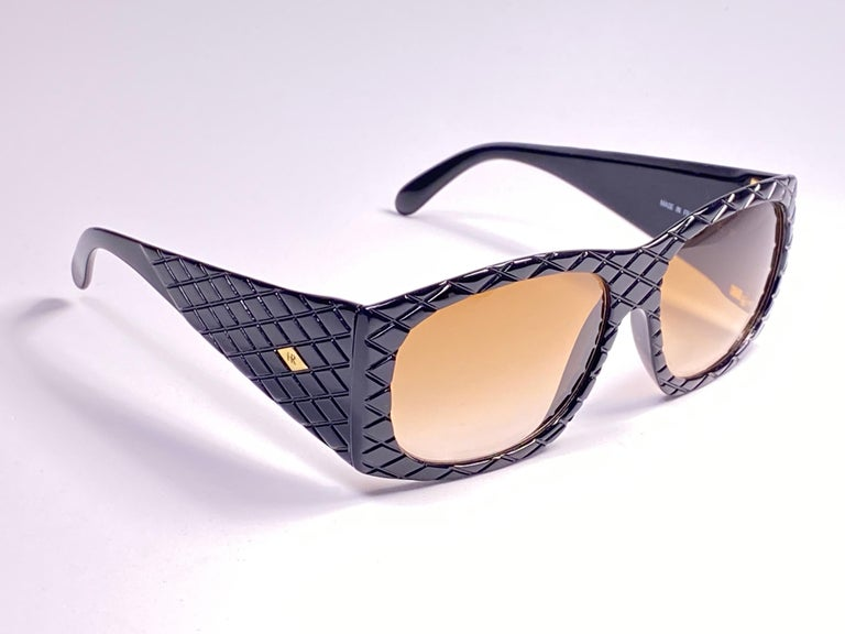 Vintage Helena Rubinstein black mask quilted frame with medium brown lenses.  Made in France.  Please notice this item is nearly 50 years old and may show minor sign of wear due to storage.