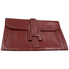 Vintage Hermes Jige  Clutch in Burgundy box Leather.