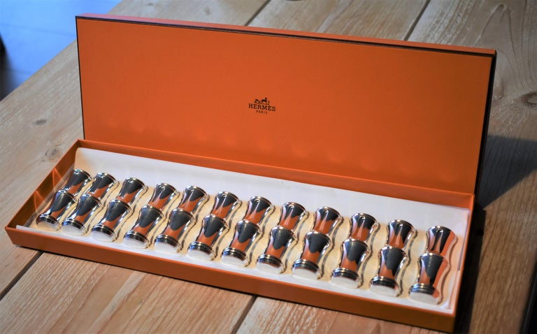 A beautiful set of 12 knife rests shaped as bamboo by Hermès. Each knife rest has two hallmarks; one of Hermès Paris and one of Ravinet d'Enfert.  The set will be send in an original Hermès box and is in very good condition.