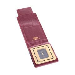Vintage Hermès Travel Pendulum in gold brushed and burgundy calfskin