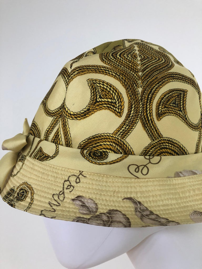 Vintage Hermes Yellow, Gold & Ivory Silk Cloche / Bucket Hat w/ Bow In Good Condition For Sale In Houston, TX