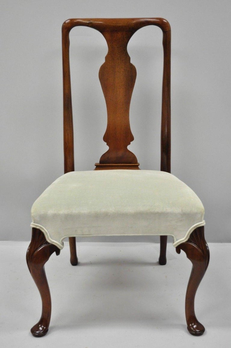 Hickory chair Company Queen Anne style mahogany dining chairs set of 4. Listing includes 4 side chairs, Queen Anne legs, green velvet upholstered seats, solid mahogany wood construction, nicely carved details, quality American craftsmanship. circa