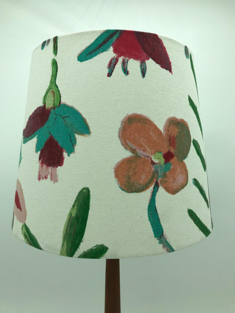 Vintage Holm Sørensen table lamp from the 1950s in teak and brass. Topped off with a beautiful limited edition lampshade from ArbyMaj in the manner of Josef Frank. Rewired and can be delivered with an EU or US plug.
