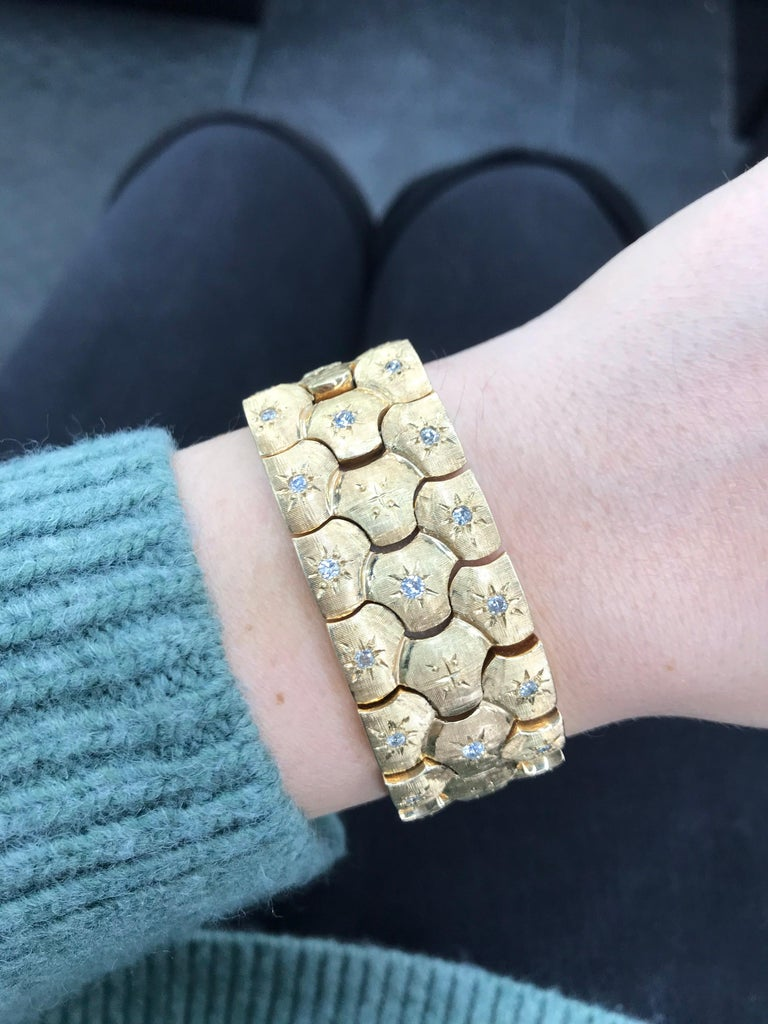Vintage honeycomb motif bracelet featuring scattered round brilliants weighing 0.60 carats, crafted in 14k Yellow Gold.